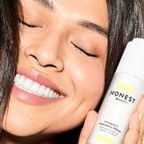 model holding skincare product
