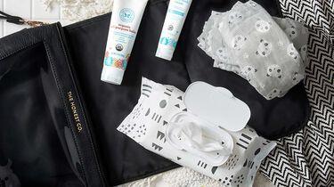 diaper bag with diaper rash cream and panda diapers