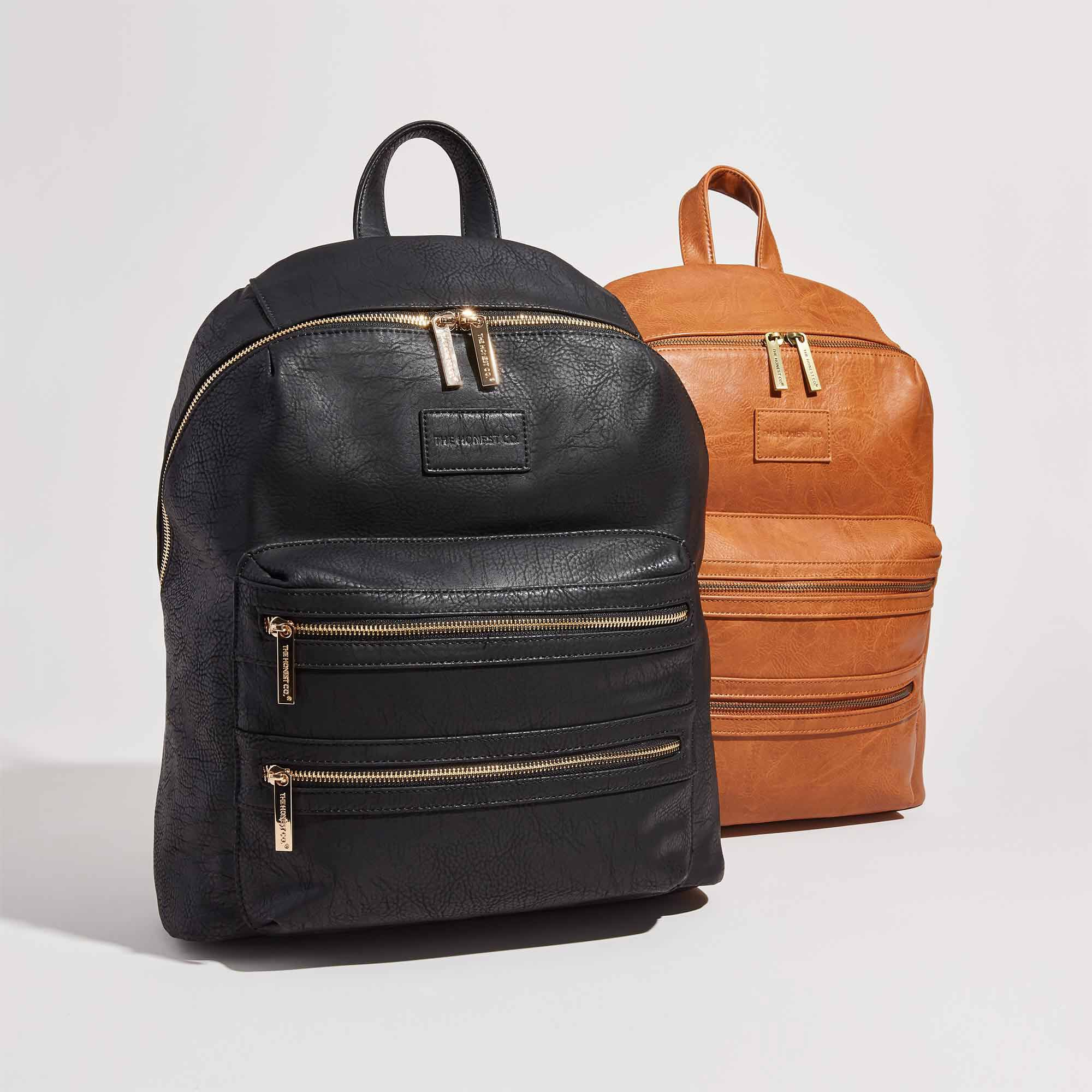 group image of both the black and cognac leather backpacks, front facing