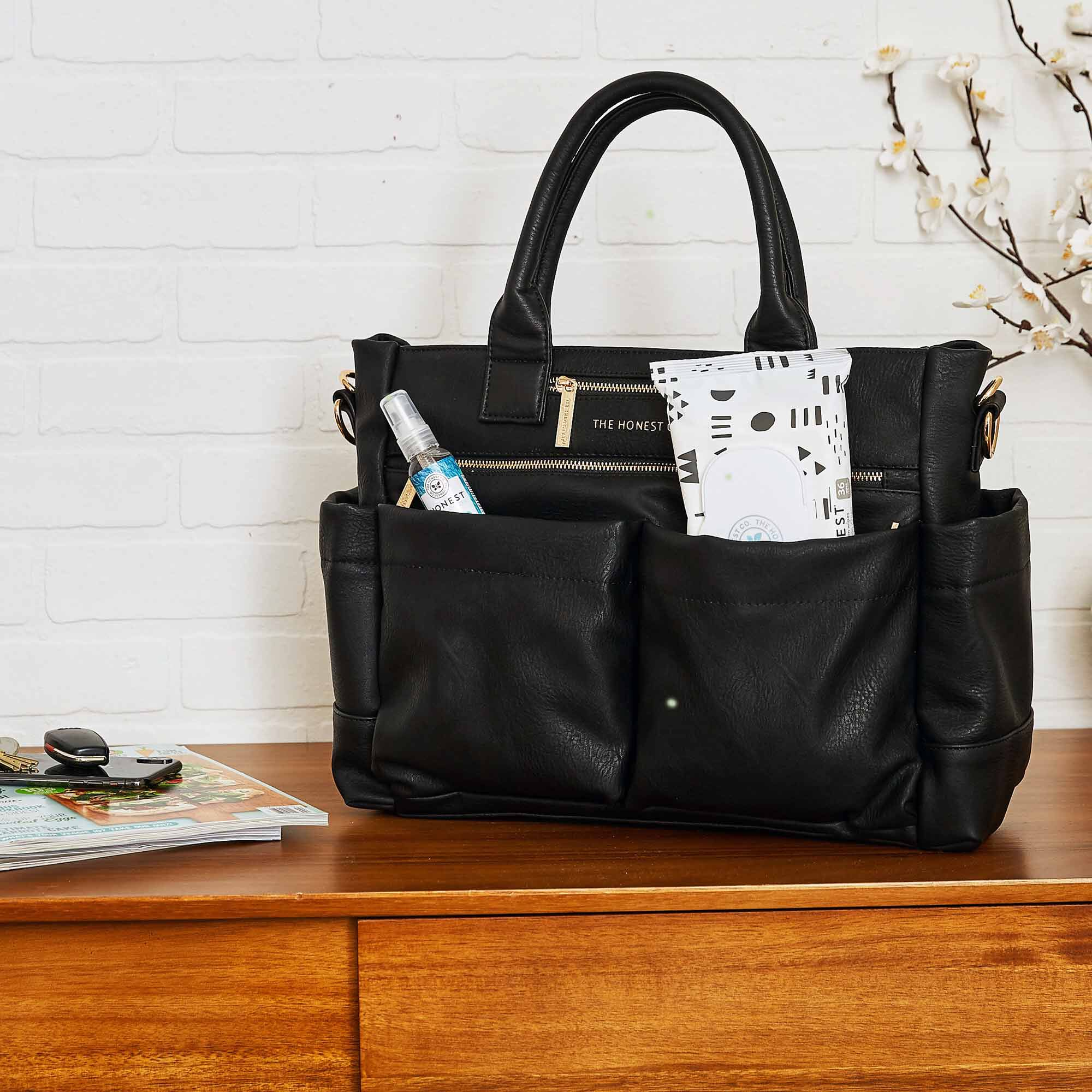 Everything tote with wipes and hand sanitizer in a home setting