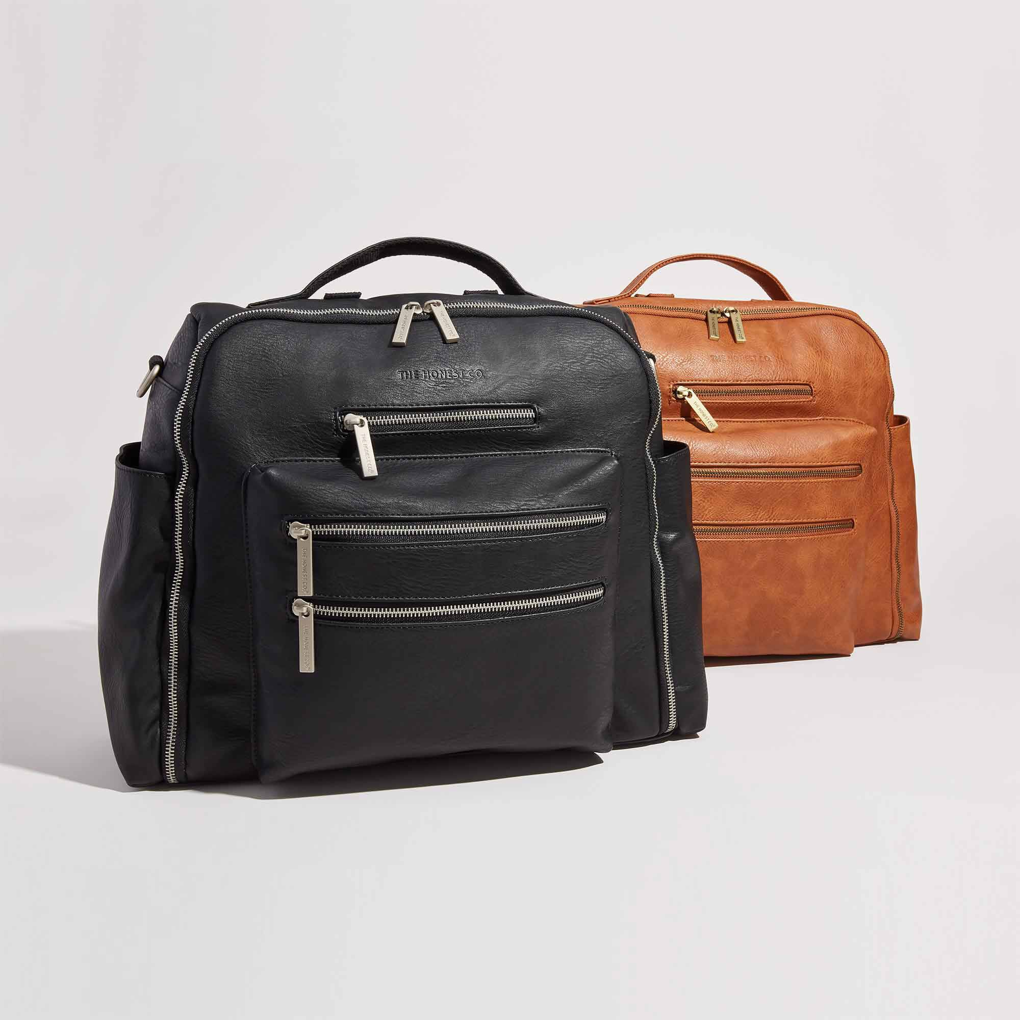 group image of both the black and cognac leather diaper bag, front of bag