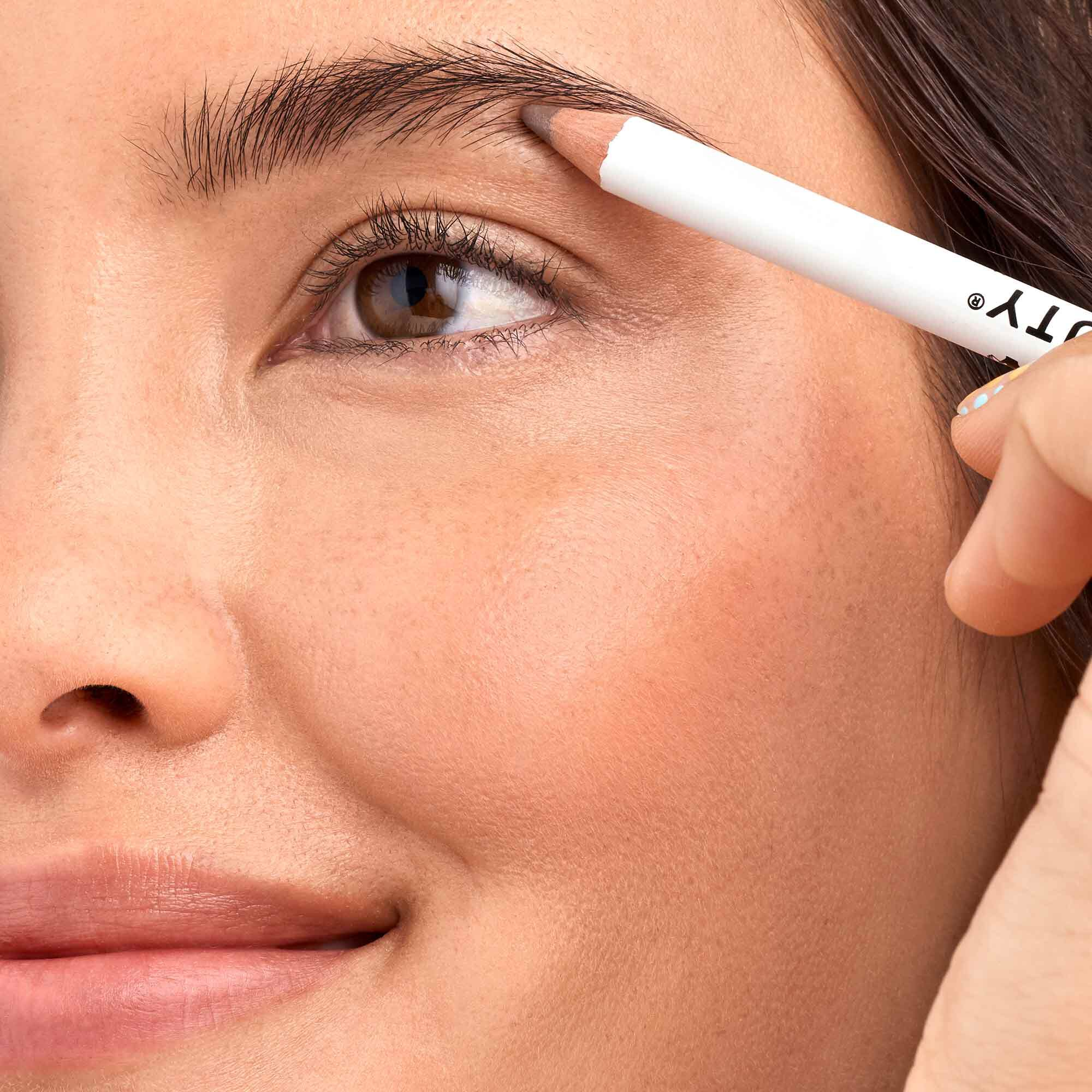 model using taupe eyebrow pencil