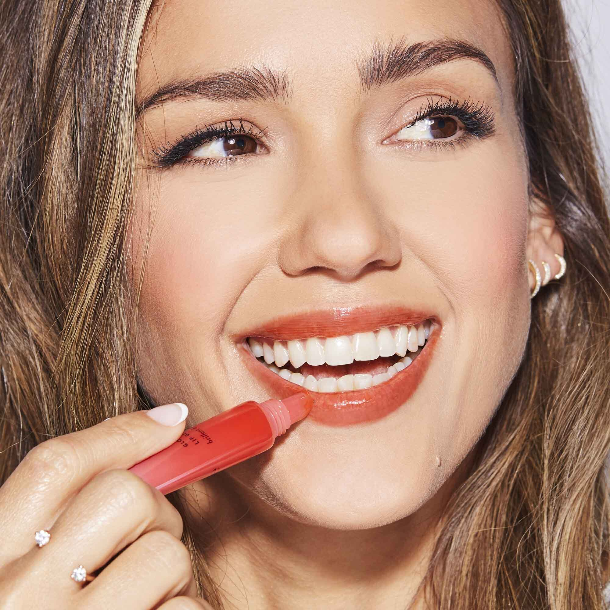 Jessica Alba applying Gloss C Lip Gloss