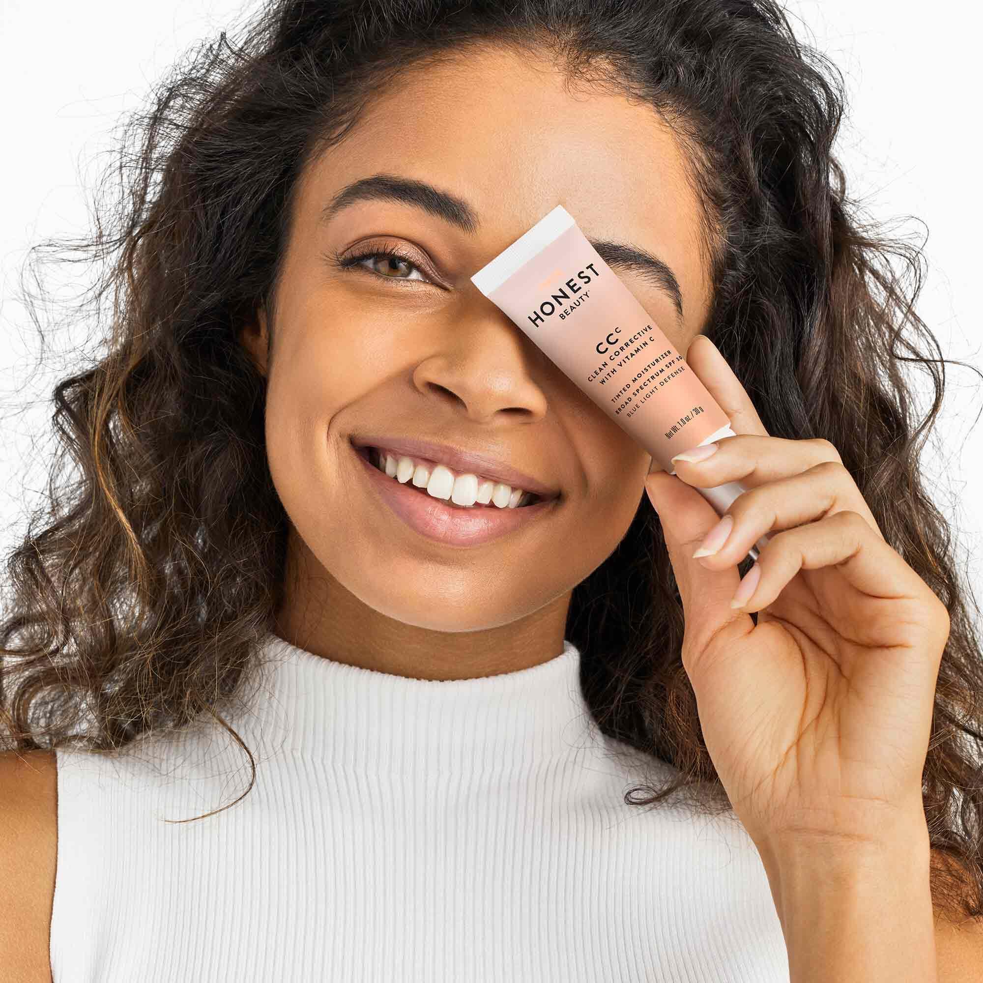 model holding moisturizer product