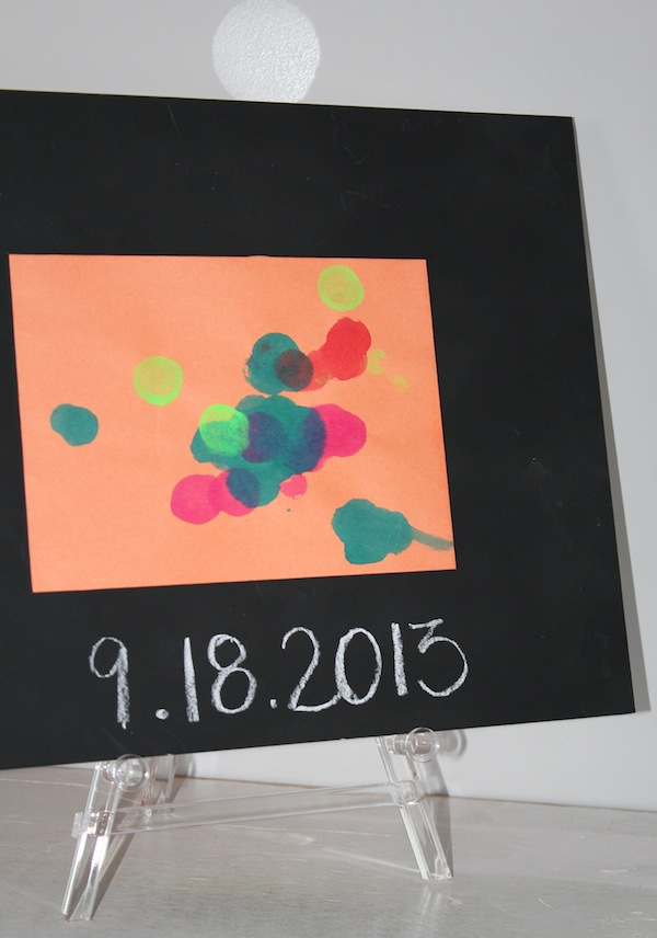 Use a Chalkboard Painted Mat to Frame Your Kids Art