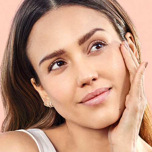 Jessica Alba with hands on face