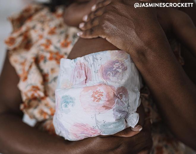 Mom holding baby in Rose Blossom Diaper